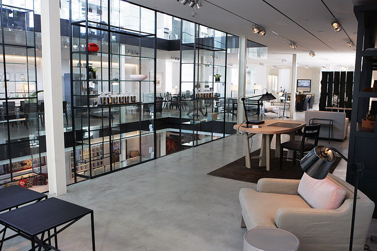 In addition to creating a psychological layer of security at the edge of the atrium, the porous design of the cases shape discrete display areas without specifically enclosing them.