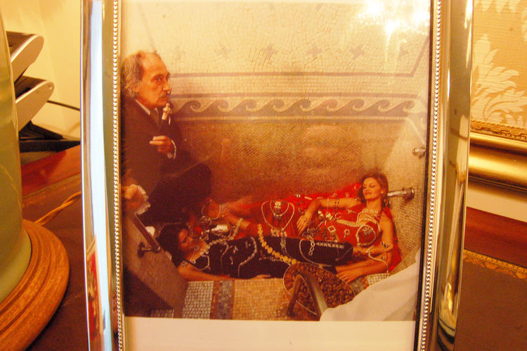 I guess the Roman bath was quite a hit with Dali—here's a photograph of the artist, enjoying the space with two young friends. Next time you're in Barcelona and you have $8,845 burning a hole in your pocket, feel free to book the two-bedroom suite and try