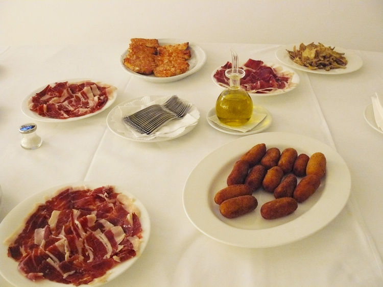"We capped our tour of the showroom with an impressive spread of Catalan specialties—Jamón ibérico, pan y tomate, Carxofes fregides (fried artichokes), croquetes, and of course the ubiquitous olive oil contained in a decanter by <a href=""http://www.dwell.c"