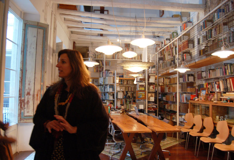 The very welcoming Benedetta Tagliabue, inside her double-height living room. The space is filled with books, objet d'arte, colorful and comfortable furniture, silk Fortuny lamps, and really, all manner of wonderful things. I hope to feature her residence