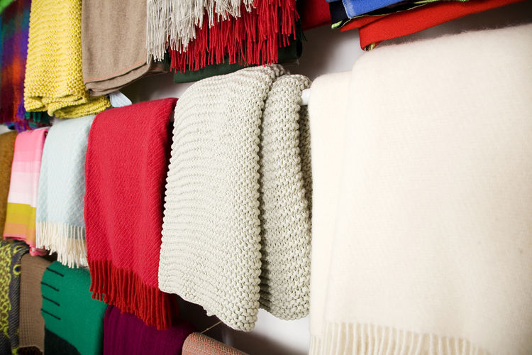 Rows of blankets line the wall, and the shop offers an international selection from 18 different countries.