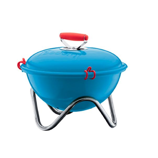 The Fyrkat Charcoal Picnic Grill by Bodum in red, steel, and blue.