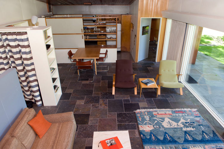 "The main living space after a healthy amount of restorative work, both structural and in the furnishings. ""There wasn't enough room to put blue stone flagging down,"" says Miller. ""As an interim solution, we put down slate. We're not sure how we're going t"