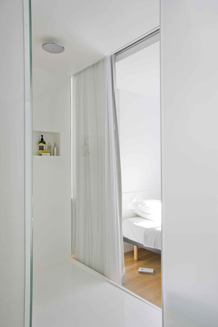 The bathroom leads to the bedroom.