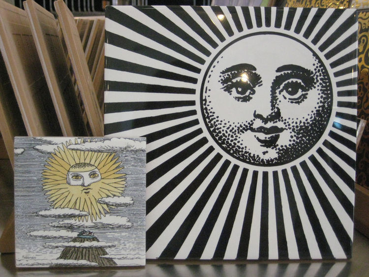 """I'm not generally drawn to Piero Fornasetti's designs but I did love these graphic suns from Ceramica Bardelli. The larger, Fornasettiana, is 8"""" x 8"""", and the smaller, from the Lunario Del Sole line, is 4"""" x 4""""."""