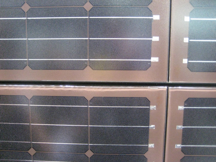 Laminam is a pioneer in producing large, thin, porcelain, photovoltaic tiles. Silicone solar cells are applied over the ceramic panels, and the resulting slabs are only 8mm thick.