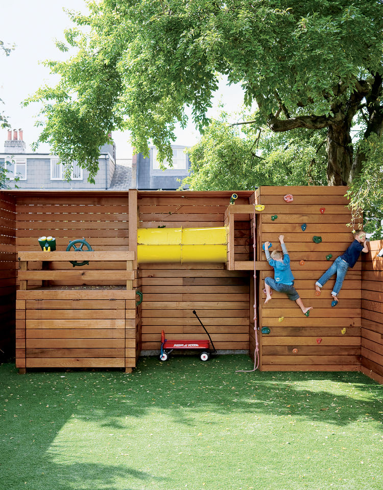 If tidiness is paramount for the family, a place for the kids to play outdoors is equally important. The climbing wall at the back of the garden is entirely the work of Mark Tiarks, who built the Composite House and who relished a chance to step out from