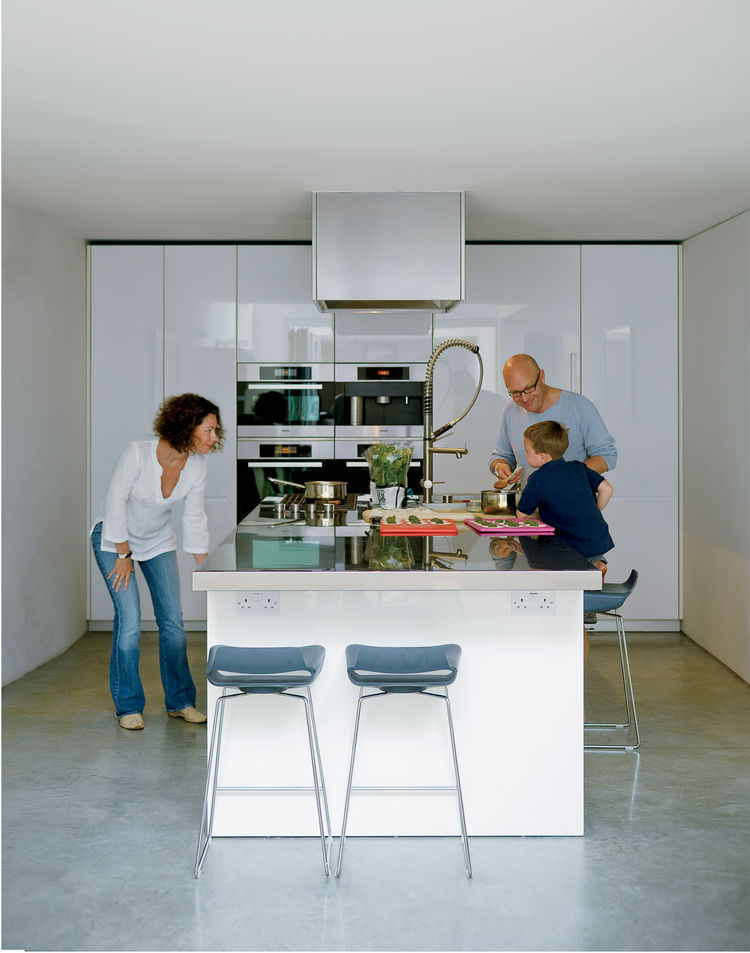 Bruce and Kirsty loved the idea of a kitchen island rather than traditional work surfaces around the walls. Bruce fancies himself a chef and hates to have his back to everyone when he's cooking. This island, from the Boffi LT line designed by Piero Lisson