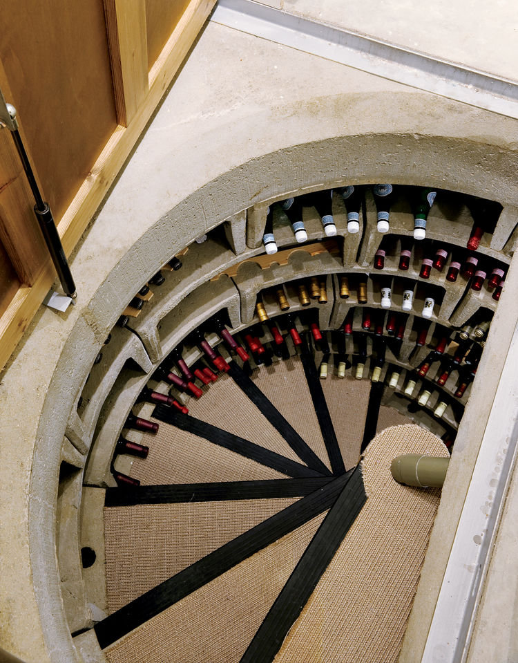 Bruce is a wine enthusiast and a stickler for efficiency, so this prefab concrete cellar with an ingenious passive ventilation system was a natural choice. It maintains a constant temperature, and its stacked horizontal bins can store up to 1,400 bottles