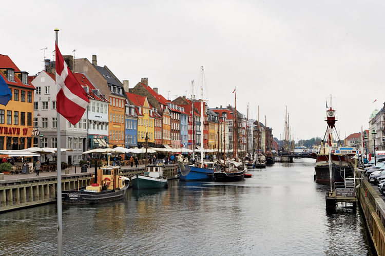 Once a red-light district and popular brawling spot for drunken sailors, today Nyhavn  is packed with restaurants and cafes, and is a starting point for canal boat tours.