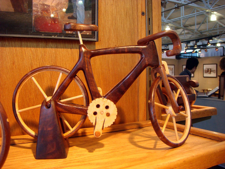 "Steve Baldwin of <a href=""http://baldwintoys.com/"">Baldwin Toys</a> creates spectacular wooden heirloom toys for adults and children and has been doing so since 1976. Among my favorites was this handsome road bike. Though based in Omaha, Nebraska, Baldwin"