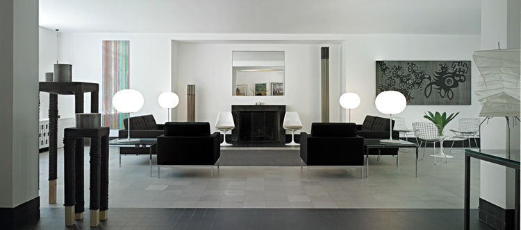 "Interior designer <a href=""http://www.charfoosdesign.com/"">Lynda Charfoos</a>, who is based in Bloomfield Hills and sits on the board of governors of Cranbrook, furnished the space with pieces by school alumni like Frances Knoll, Harry Bertoia, Charles Ea"