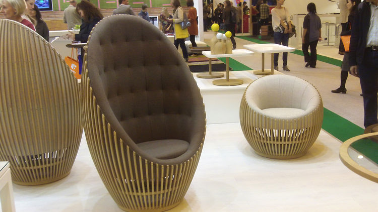 """Samuel Chan is the nearly eponymous owner of the two-year-old furniture label <a href=""""http://www.channelsdesign.com/home.php"""">Channels</a>. The lightly quilted Motley throne chair has a wooden baton structure and turns on a rotating plate at its foot."""