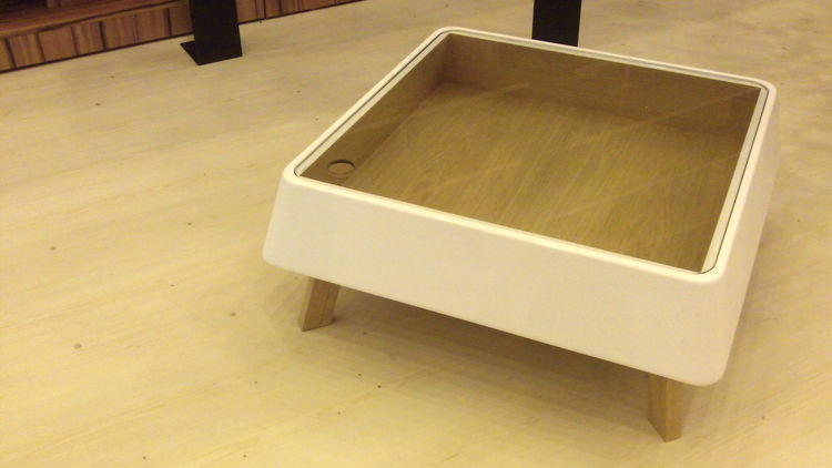 One of some beautiful wooden pieces in the Chilean booth, the Tecla coffee table by Juan Pablo Fuentes & Asociados, which is made from MDF. It features a plywood interior and a glass top punctuated with a hole-cum-handle that can be lifted to store magazi