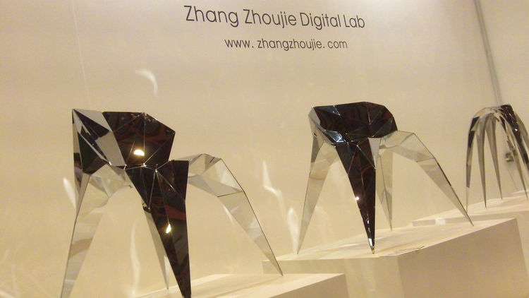 "Shanghai-based <a href=""http://www.zhangzhoujie.com/"">Zhoujie Zhang</a> graduated from the Central St. Martins in 2010 and returns to London with a series of faceted chairs cut and folded from a single sheet of mirror-finished steel. Zhang scanned friends"