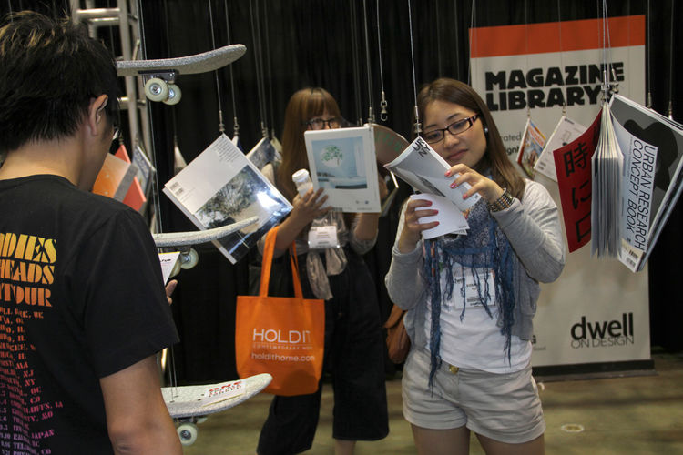 """Fashion and design magazines adjacent to the <a href=""""http://www.dwell.com/slideshows/yakitate.html"""">Yakitate</a> exhibition on the show floor dangled like chandeliers for people to flip through.<br /><br />Photo by Tammy Vinson."""