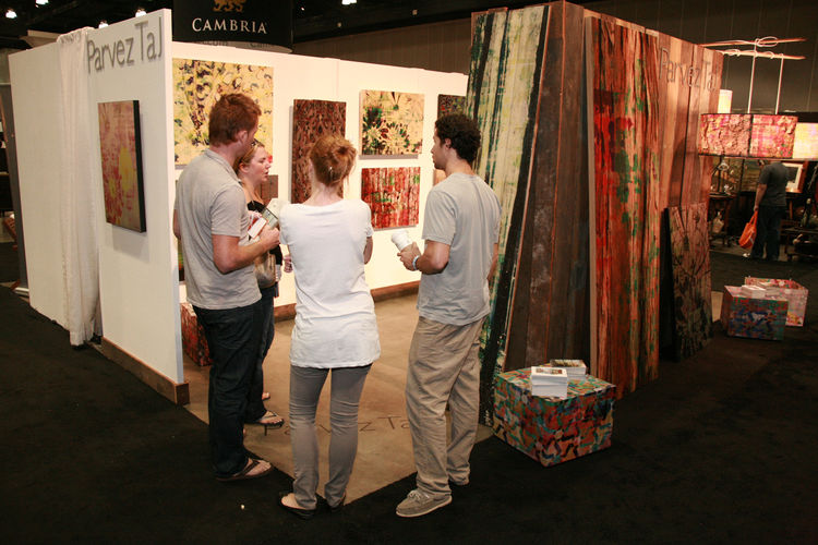 "Artist <a href=""http://www.parveztaj.com"">Parvez Taj</a> had a booth near the entrance and was showing his work, which includes prints on canvas, aluminum, mirror, glass, acrylic, bamboo, and reclaimed wood."