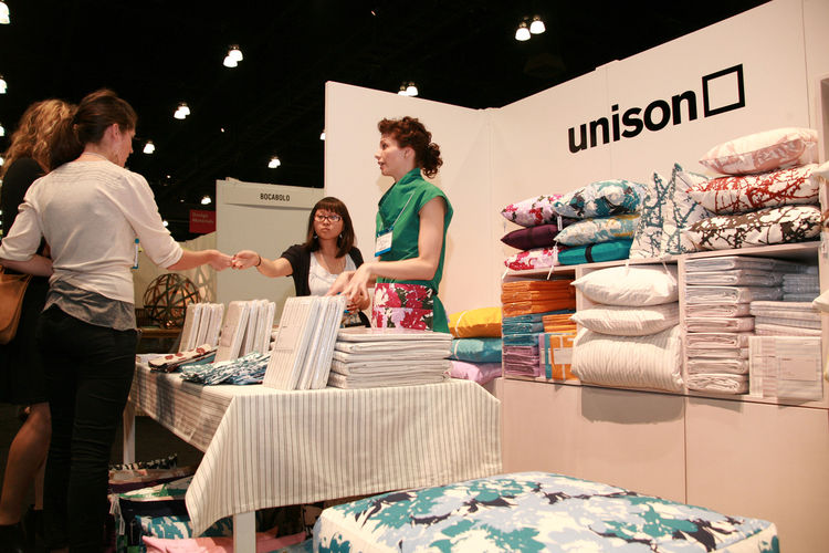 "<a href=""https://www.unisonhome.com/"">Unison</a> was back at Dwell on Design with a booth made colorful with a bounty of bedding. The Chicago-based company, launched in 2006 by husband-wife team Robert Segal and Alicia Rosauer, were one of many exhibitors"