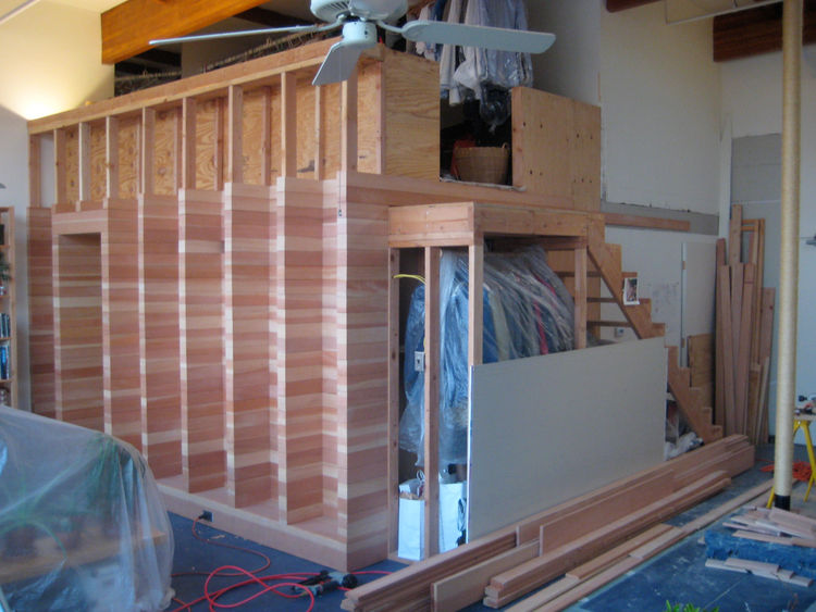 And here's the wood box about half-way completed. Once I figured out how to get into a rhythm on each of the cladding courses (all the way across), I could lay one in about a half an hour. I tried to keep the heartwood (dark) and sapwood (light) portions