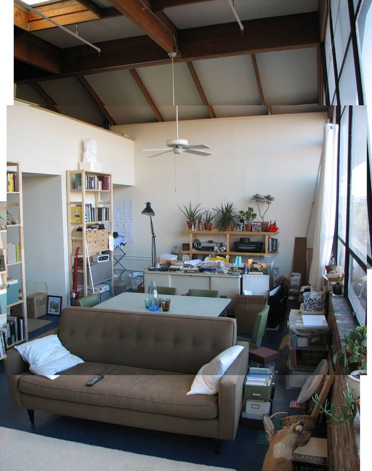 And the other side of the room. The washer and dryer are tucked into the far left corner, facing straight into the main living space—again, very strangely located. The far end of the loft was built under the sloping section of the roof so you couldn't sta