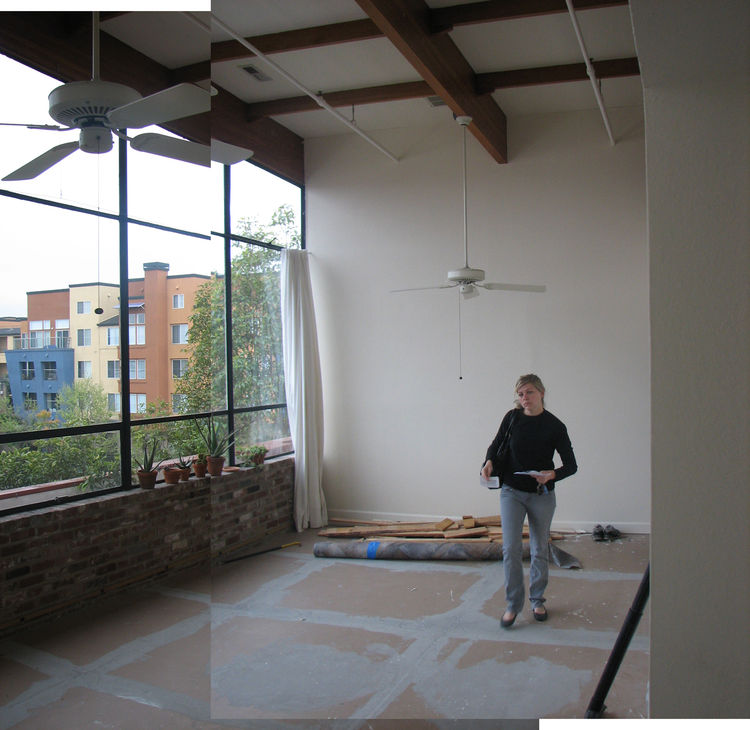 Here's Lynda in the living room, after we pulled up the vinyl. We put in some bids to contractors to grind the concrete down and seal it so its natural texture would show through, but the process was too expensive.