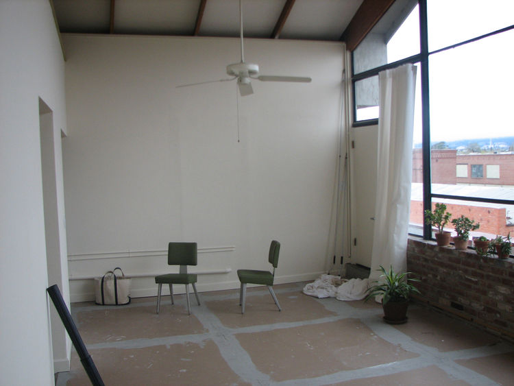 Another shot of the living room, before we moved in. You'd never know it, but the kitchen is behind that wall. And note the curtains, which were hanging off of a piece of droopy aircraft cable. We lived with these for a while, before we bought our shades.