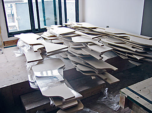 Plywood pieces are stacked in sequential order in readiness for installation in the Deform House.