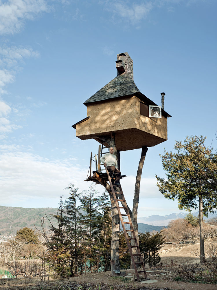 "Fujimori's retreat in Nagano, The Too-High Tea House, which is adorned with a roof of hand-rolled copper sheets, seems precariously perched atop a pair of tree trunks 20 feet in the sky. Why two? ""One leg is dangerous and three legs are too stable and bor"