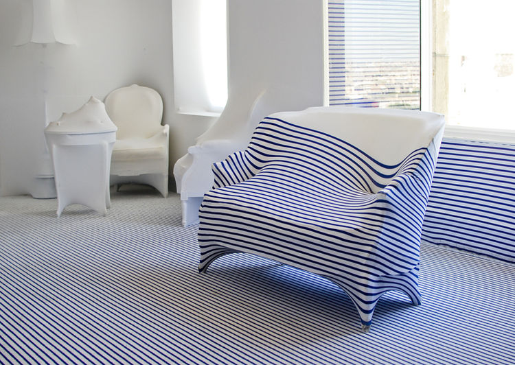 In collaboration with Roche Bobois and French Elle Decoration, Gaultier's showcase of this suite seems like a perfectly timed gateway between two realms of design. Word on the street is that fashion's enfant terrible will be launching a home furnishings l