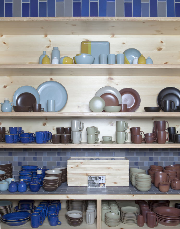 A tableau of tableware at the Ferry Building location shows the range of glaze options and styles of stoneware available. This year's summer collection is featured on the top shelf, above platters, mugs, bowls, and a small teapot from the traditional Coup