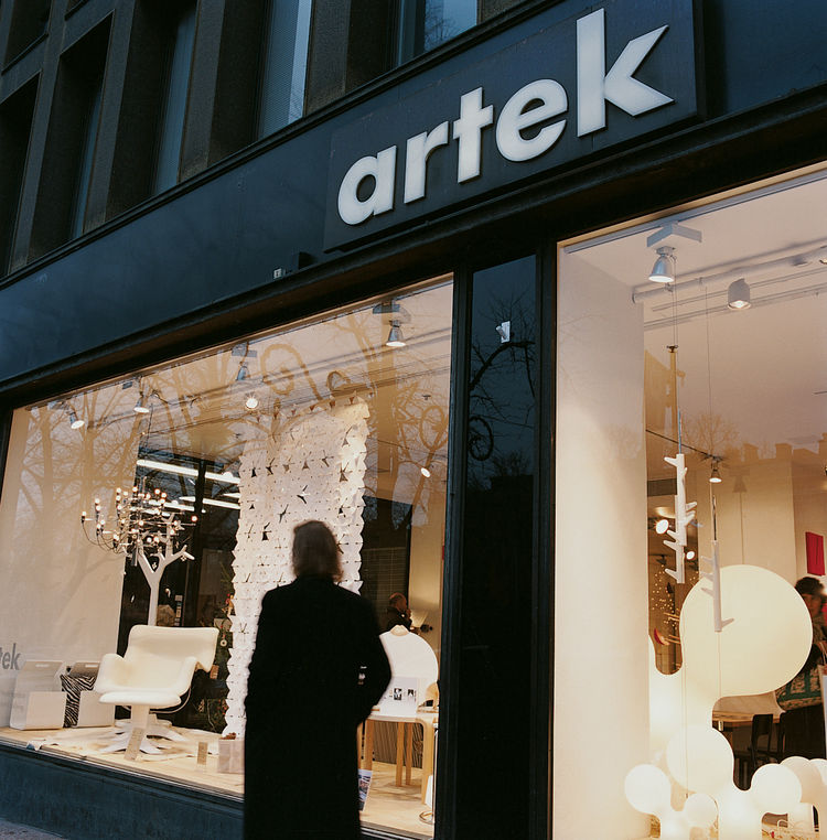 A passerby window shops at Artek, the furniture company founded by Aino and Alvar Aalto in 1935.