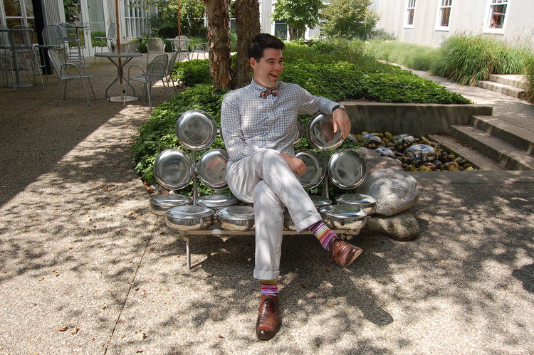 Aaron Britt, in a moment of jovial repose. He's sitting on a metal sculpture of George Nelson's famous Marshmallow Sofa, designed for Herman Miller in 1956. Though this one may not be as comfortable as the real thing, it's just as striking.