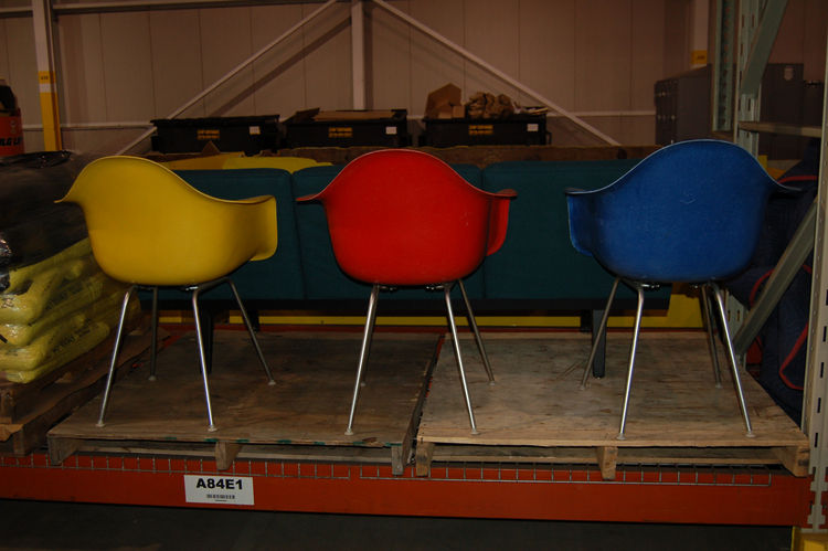 """We headed over to a big warehouse space to look for hidden gems. Here we see a trio of vintage <a href=""""http://hermanmiller.com/Products/Eames-Molded-Plastic-Chairs"""">Eames Plastic Arm Chairs</a>, which were first produced in 1950. The Eames first introduc"""