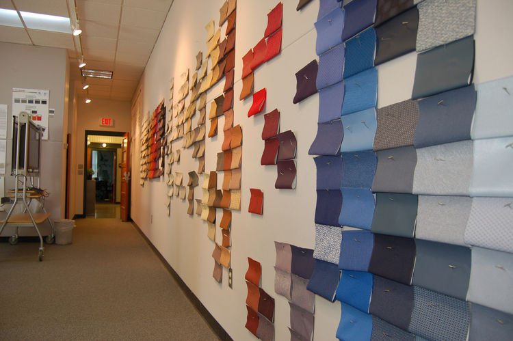 """Inside the colors and materials studio, a wall reflects a work in progress: grouping the existing textile collection into color families that progress from warm to cool and light to dark. """"Textiles are the poster children for color,"""" says Lyon. """"With text"""