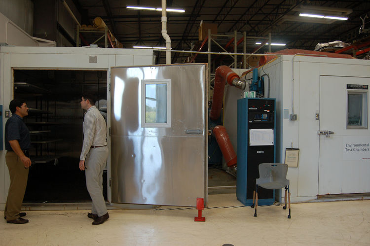 """There are various chambers that the company uses to test """"real life"""" conditions. Here we see Aaron Britt and Herman Miller's own Mark Schurman investigating the humidity chamber. There's also a chamber for extreme cold, and one for salty air. Just in case"""