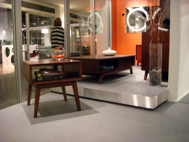 "Over at home theater specialists BDI, the <a href=""http://www.bdiusa.com/furnishings/tables/eras_table.shtml"">Eras</a> collection was prominently displayed in the showroom window."