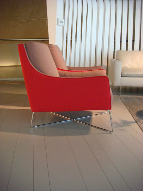 "The Shanghai armchair by <a href=""http://www.italsofa.com/en/"">Italsofa</a> boasts cherry-red fabric and seemingly delicate metal base."