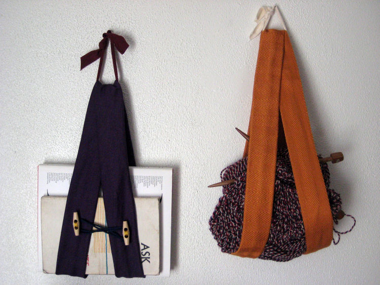 Anything goes! Sling away! Here's the purple guy with an orange one I made over the holidays. I tossed my knitting in there (it worked because those skeins are pretty hefty), but you could just as easily stash a notepad, incoming/outgoing mail, magazines.