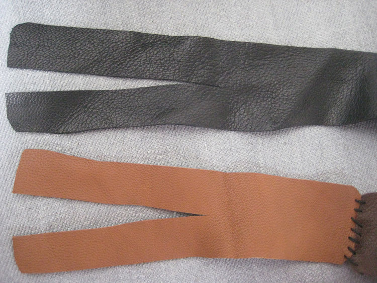 When it's all stitched together, cut about three inches down the center of both ends of the very long strap.