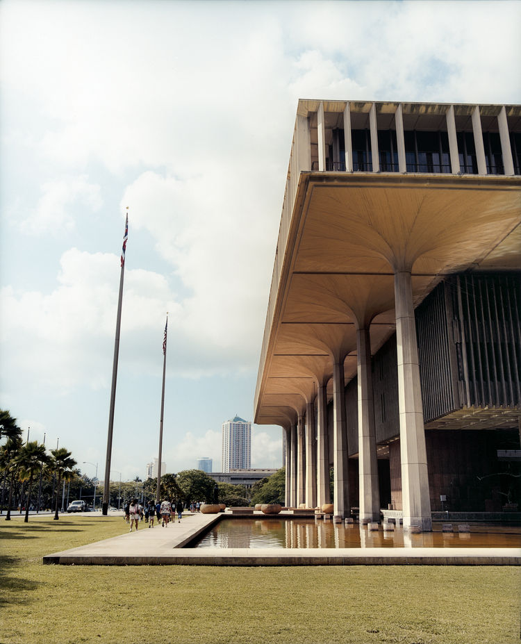 Built in 1969, the Hawaii State Capitol is rich in symbolism: The columns recall native coconut palms and refer to the eight major Hawaiian islands.