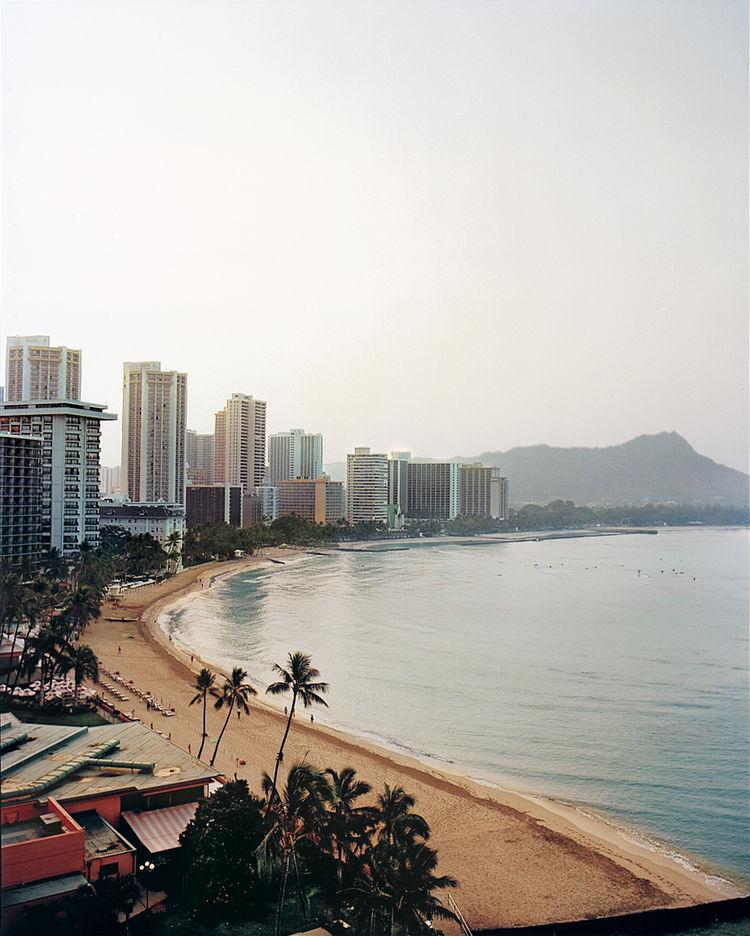 The humpbacked Diamond Head looms behind Waikiki Beach.