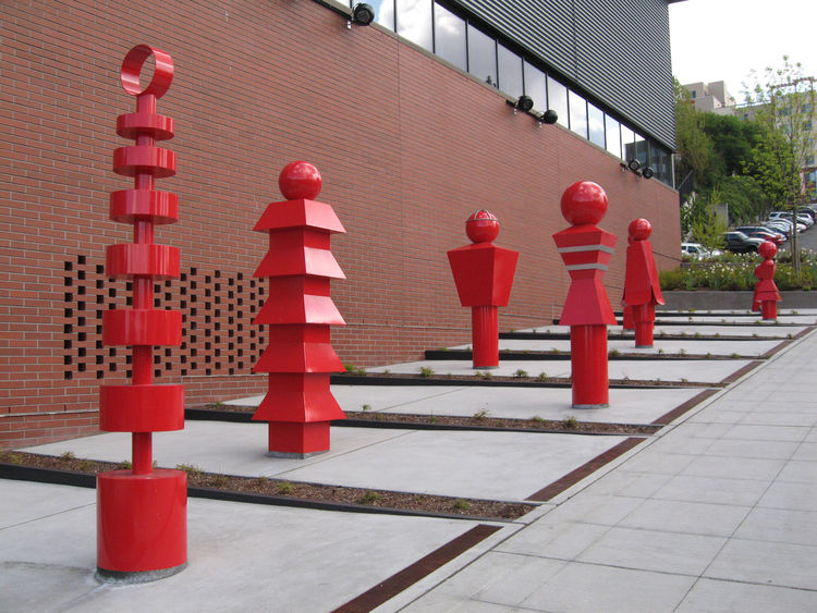"<strong>""Sentinels"" by Gloria Bornstein</strong><br /><br /> Inspired by Asian art, architecture, kokeshi dolls and even safety gear, the eight painted steel forms symbolize ""guardians of the city."" Located near Seattle's Chinatown-International District"