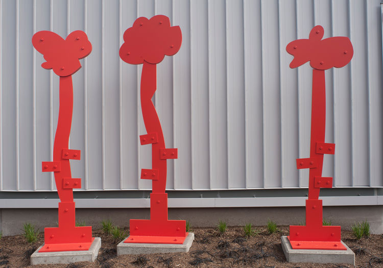 "<strong>""Alex, Michael"" by Mel Katz</strong><br /><br /> The three abstract painted aluminum sculptures—red, of course—resemble small trees outside Fire Station 38. The playful attempt to mimic the adjacent row of columnar trees also serves as a counterpo"