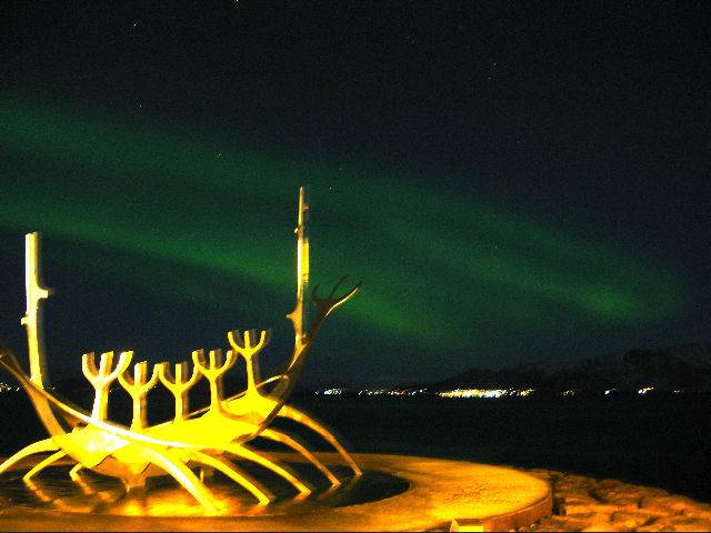 "Despite an unfavorable sun cycle and the most light-pollution anywhere in the country, aurora borealis was still visible from downtown Reykjavik. Although it's one of the most over-photographed sites in the city, the sculpture ""<a href=""<a href=""http://ww"