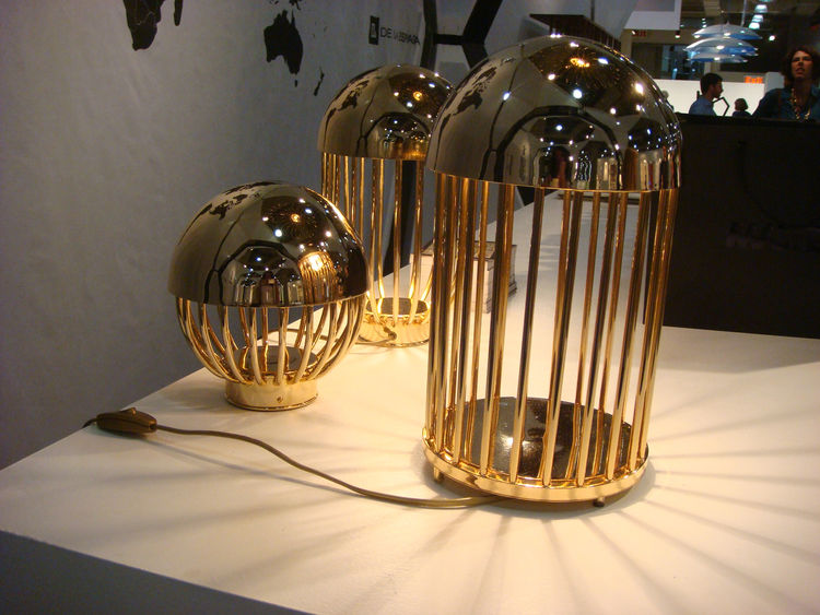 "Autoban's new collection for De La Espada included these gold-plated <a href=""http://delaespada.com/index.php/us/product/select/280"">Pill lamps</a>. Though not brass, the objects are indicative of the warmed-toned metallics we saw throughout the fair. (Re"