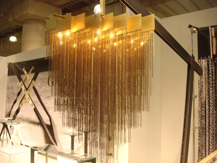 "The Kelly chandelier by <a href=""http://www.gabriel-scott.com/www.GABRIEL-SCOTT.com/HOME.html"">Gabriel Scott</a> hangs off of a blackened steel base. If brass was the number one material trend, blackened steel was a close second in terms of metals. They d"