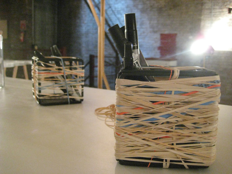 The American Design Club curated an exhibition on the third floor of the building called Use Me, emphasizing various forms of functionality. Craighton Berman's Rubber Band Cube gives the old ball corners, and a place to put pens.
