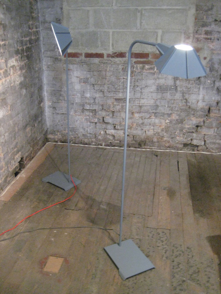 Brendan Ravenhill's floor lamps matched the industrial aesthetic of the space.