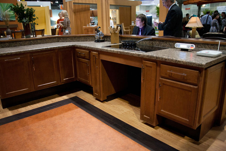 Kitchens designed for seniors in wheelchairs wisely eliminate base cabinets and drawers under cooktops and raise toekicks to 8½ inches all around so that burner controls and work surfaces can be reached more easily. For seniors who can walk, slip-resistan