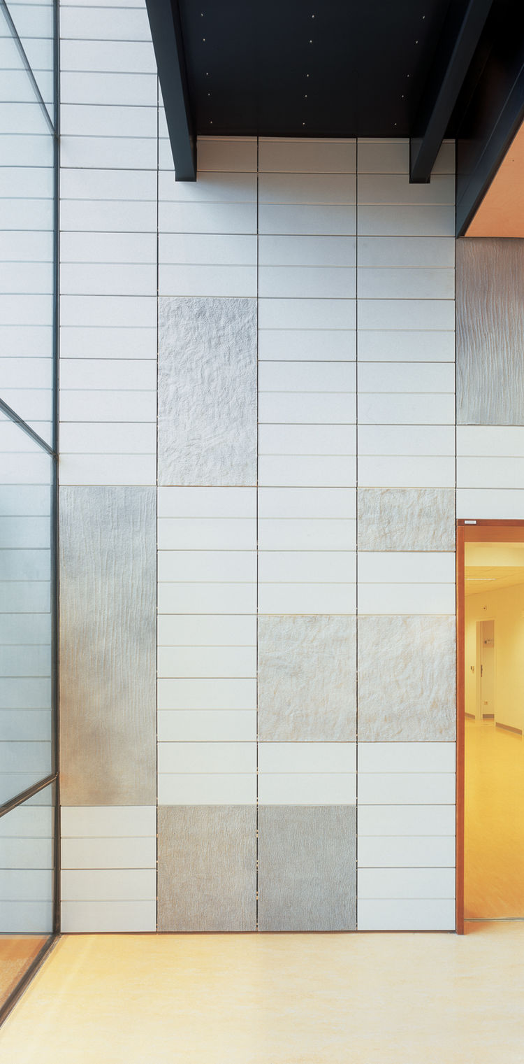 Tiles of natural felt dot the walls in the Universitair Medisch Centrum, Utrecht. Jongstra was asked to create a warmer feeling for this wing of the medical center, where people come for radiation and chemotherapy treatment.